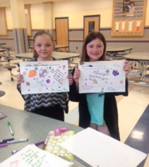 Children decorating placemats for noon-time meals at Norwood Non-Profit Fair