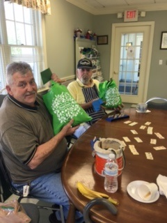 Plainville seniors show off their fresh food bags they received from Project 351